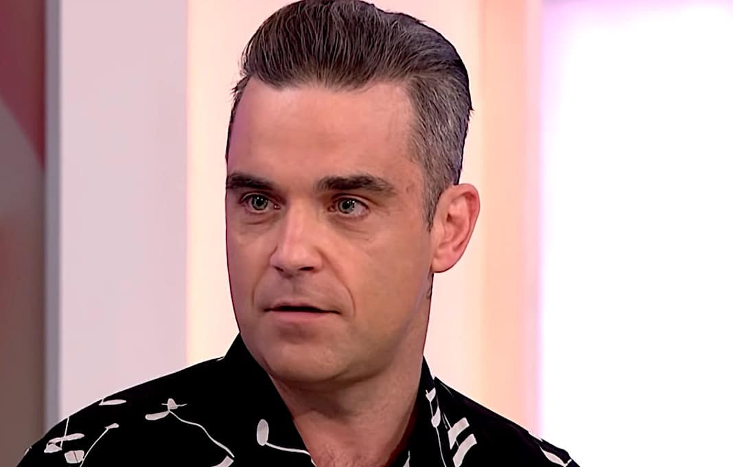 I Queen chiesero a Robbie Williams di entrare nella band